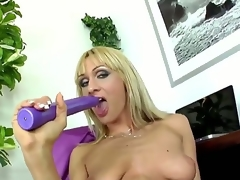 Provocative whorish blonde milf Cherry Cock juice with cheep enormous make up and long nails in stockings and high heels teases and stuffs moist love tunnel with long violet sextoy to orgasm.