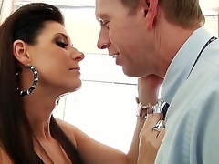 India Summer gives Mark Wood a blow job in the bathroom. This dark haired temptress looks absolutely stunning as this babe sits astride the toilet seat in her sexy underclothing and fish net stockings as this babe sucks on Marks hard cock.