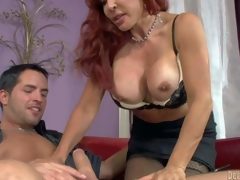 Sexy Vanessa is a good looking big breasted older redhead. She turns on her step-son with her juggs and takes his rock subrigid cock in her experienced mouth. Watch stacked milf give headjob