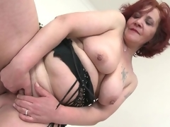 Old lady with red hair masturbates her cum-hole