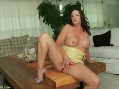 Tight yellow dress on curvy brunette milf
