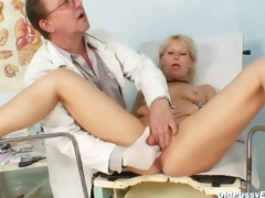 Aged Romana gynochair slit speculum examination by gyno doctor