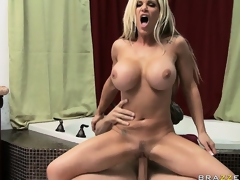 Stacked blond uses her fake whoppers to rub and squeeze a big dick