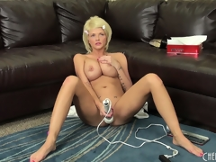 Busty golden-haired Joslyn toys her pussy and vibrates her clit on the couch, then gets on the floor