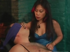 Older Oriental Dominatrix Sits Submissive Male on the Servitude Chair